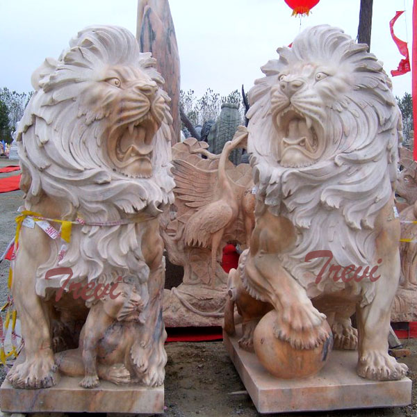 Pair of guardian lions statue with ball in front of house TMA-31