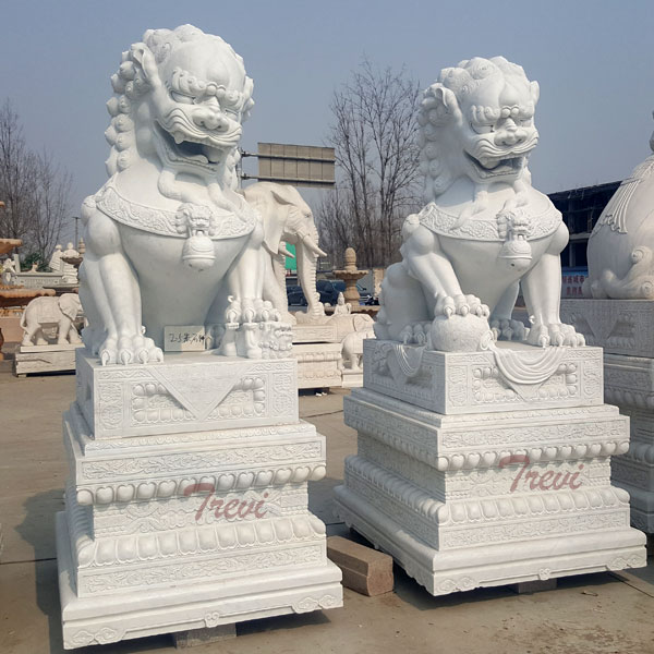 Carved stone lion guardians fu dog pair with base in front of house TMA-100